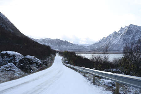 Snowy dangerous road in winter conditions in Norway Stock Photo