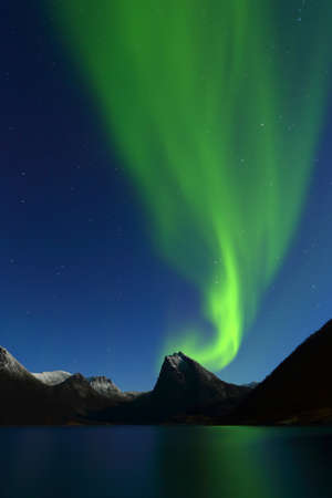 Beautiful green northen lights in norway landscape. Vertical composition Stok Fotoğraf