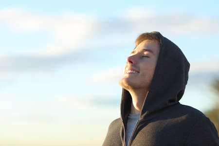 Portrait of a teenage boy breathing deep fresh air Stock Photo