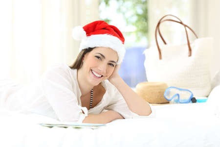 Hotel guest looking at you on christmas holidays lying on a bed in an hotel room
