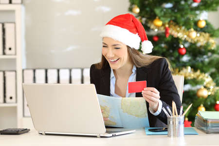 Joyful executive planning christmas holidays booking hotels on line at office