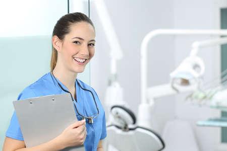 Happy dentst girl posing in a dental clinic interior