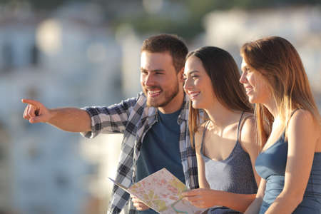 Group of happy tourists contemplating views on vacation at sunset Stock Photo
