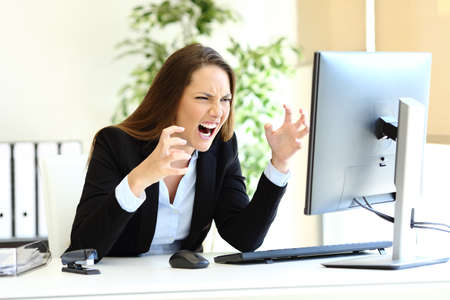 Angry office worker loosing control checking computer content