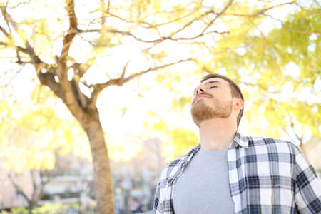 Portrait of a man relaxing breathing deep fresh air in a park Stockfoto