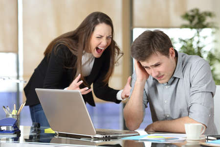 Businesswoman harassing an intern shouting and scolding at office