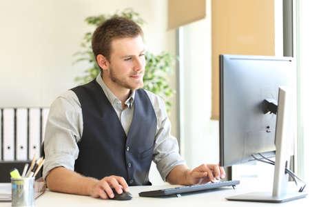 Serious executive browsing desktop computer content sitting at office