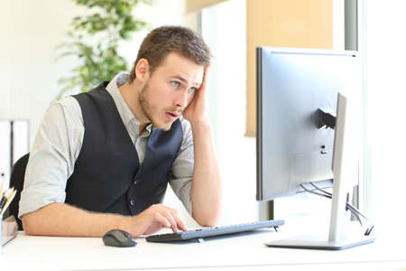 Worried executive complaining after discover mistake on computer at office