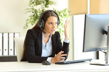 Angry office worker complaining attending bad client on phone