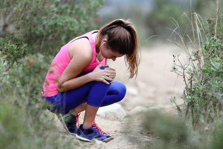 Stressed runner complaining suffering knee ache training outdoors