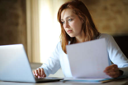 Concentrated entrepreneur working online at home or hotel room