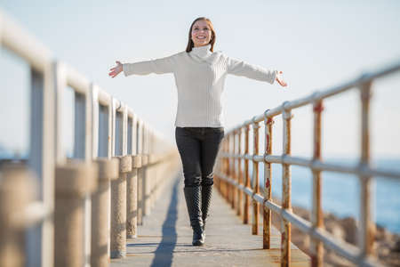 open arms: young woman with open arms walking, selective focus Stock Photo