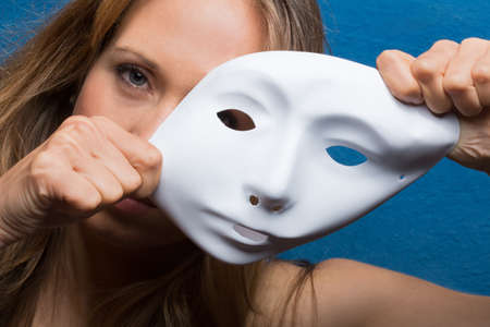 two faced: angry female face semi covered with white mask