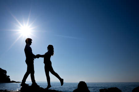 18 20 years: silhouette of happy teenager couple on the beach Stock Photo