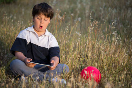 scared boy: scared boy surfing in the internet, selective focus Stock Photo