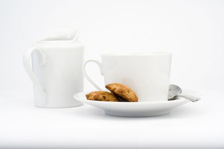 white cup isolated over white milk and spoon Stock Photo - 3503996