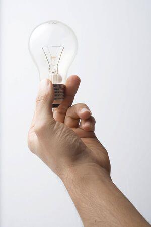 human hand get a light bulb photo