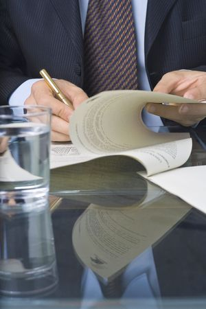 businessman signing an agreement after negotiation in the meeting room photo