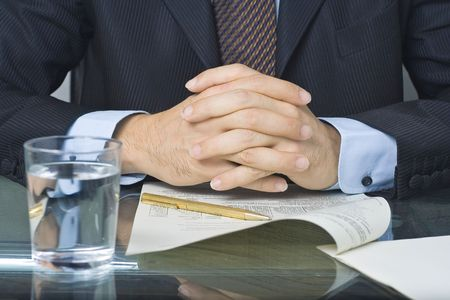 negotiation business: businessman signing an agreement after negotiation in the meeting room