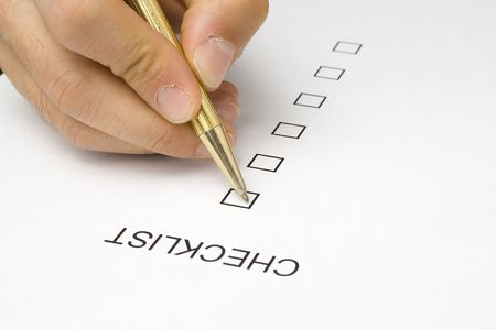 businessman filling out a questionnaire quality of service photo