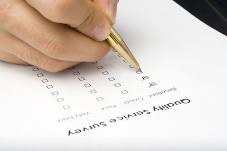 filling out: businessman filling out a questionnaire quality of service