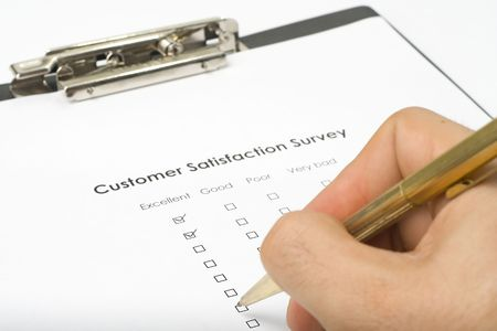 businessman filling out a questionnaire quality of service Stock Photo - 3713614
