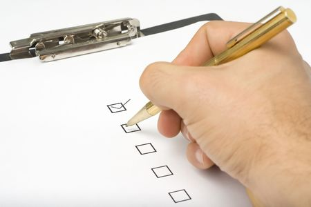 businessman filling out a questionnaire quality of service Stock Photo - 3713619