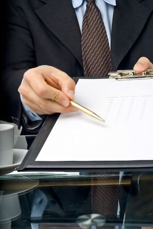 businessman filling out a questionnaire quality of service Stock Photo - 3733793