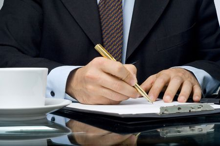businessman filling out a questionnaire quality of service Stock Photo - 3733796