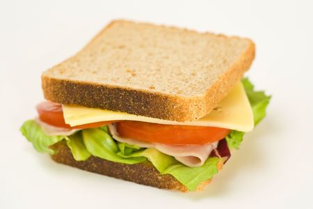 ham sandwich: A delicious and healthy sandwich turkey ham cheese lettuce tomato and onion Stock Photo