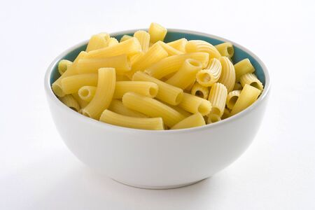 fresh uncooked raw italian pasta isolated over white photo
