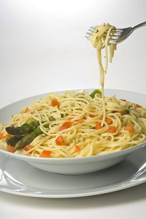 natural fresh spaghetti with tomato sauce and asparagus photo
