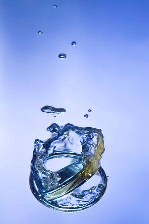 alliances: two marriage alliances splashing on cool water