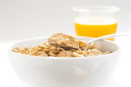 bowl of cereal with raisins, milk and orange juice Stock Photo - 4140103