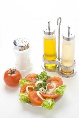 fresh natural salad bowl tomato lettuce onion oil vinegar photo