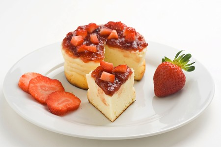 cheesecake with fresh strawberries and blackberry jam isolated over white photo