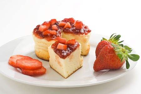 cheesecake with fresh strawberries and blackberry jam isolated over white Stock Photo - 4209098