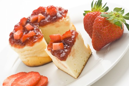 cheesecake with fresh strawberries and blackberry jam isolated over white Stock Photo