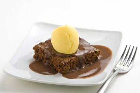 hot chocolate brownie with walnuts and vanilla isolated photo