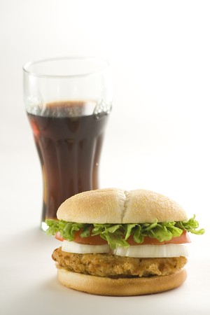 crisp chicken burger with tomato onion cheese lettuce isolated Stock Photo - 4302570
