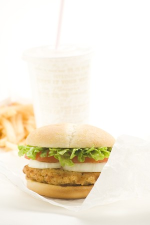 crisp chicken burger with tomato onion cheese lettuce isolated Stock Photo - 4302604