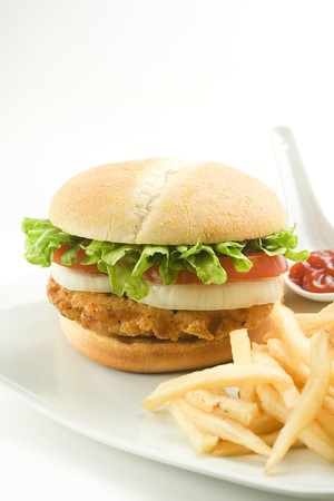crisp chicken burger with tomato onion cheese lettuce isolated Stock Photo
