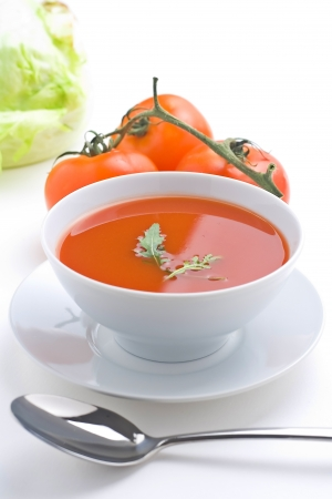 hot soup: delicious and healthy homemade tomato soup and vegetables isolated  Stock Photo
