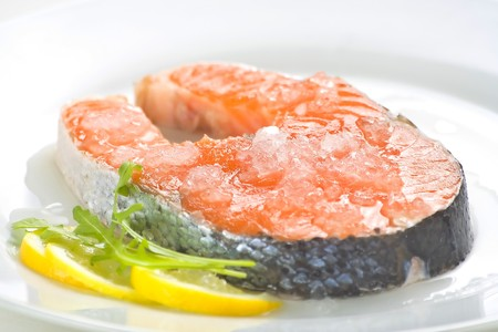 slice of fresh salmon and healthy isolated over white