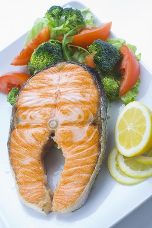 fresh salmon cooked with tomato salad broccoli salad photo