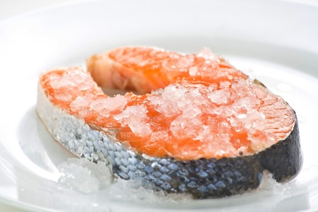 slice of fresh salmon and healthy isolated over white photo