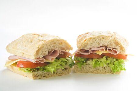 delicious sandwich of ham cheese lettuce fresh tomato photo