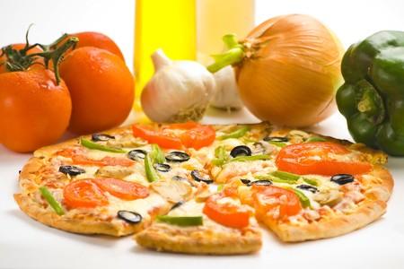 homemade pizza with fresh tomato olive mushroom cheese isolated Stock Photo - 4512854