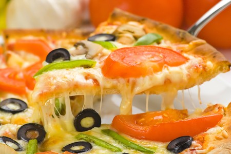 homemade pizza with fresh tomato olive mushroom cheese isolated Stock Photo - 4512902
