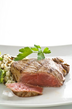 delicious beef grilled whith rice and vegetables photo
